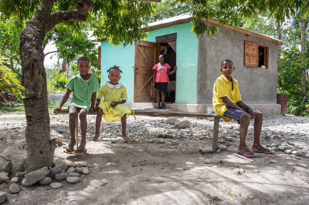 1000 families project the dumolas family recovering together five years after haiti earthquake