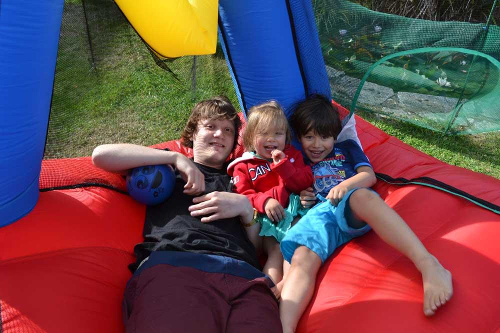 1,000 Families Project: Paula, Simon, Raven, Aidan and Maya on bouncy castle