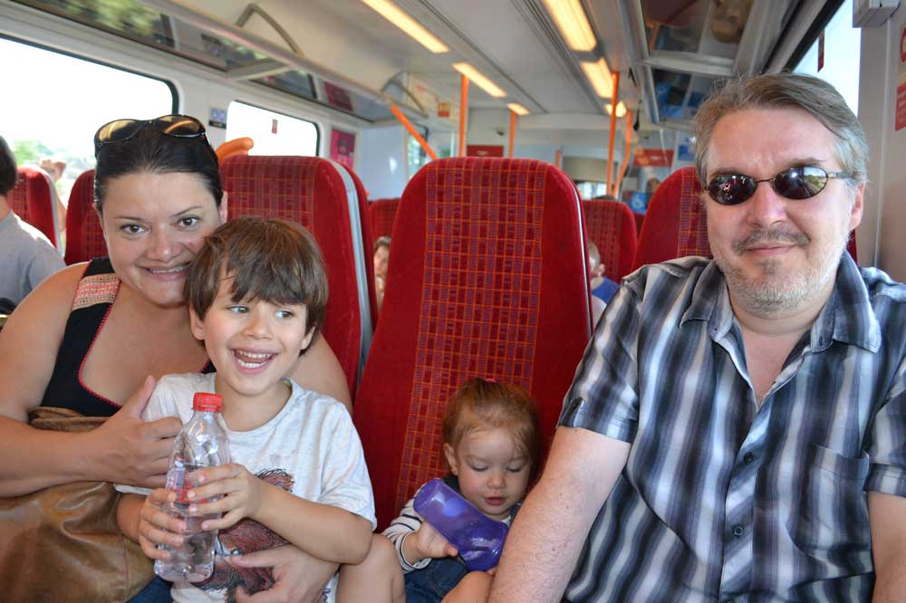 1,000 Families Project: Paula, Simon, Raven, Aidan and Maya on the train